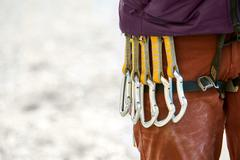 quick-draws on the  climber's harness - stock photo