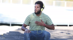 African american man with headphones listening to music Stock Footage