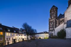 The catholic Herz-Jesu church in Aachen Burtscheid, Germany with night blue s Stock Photos