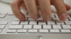 Man Typing on White Keyboard - 4k Stock Footage