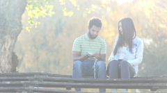 Couple starting to listen to music on smartphone, sharing earphones Stock Footage