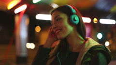 Young woman dancing to the rhythm of music with headphones - stock footage