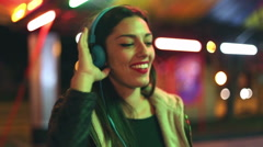 Beautiful woman dancing to the rhythm of music with headphones Stock Footage