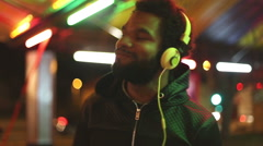 Handsome man dancing to the rhythm of music with headphones - stock footage
