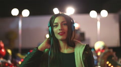 Beautiful woman dancing to the rhythm of music with headphones - stock footage