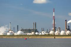 A large refinery with gas storage tanks in the port of Antwerp, Belgium with  - stock photo