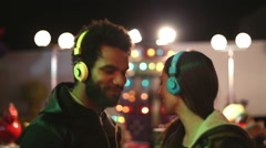 Man and woman dancing to the rhythm of music with headphones Stock Footage