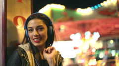 Girl dancing to the rhythm of music with headphones - stock footage