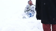 man lying in the snow - stock footage