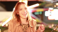 Beautiful woman dancing in amusement park - stock footage
