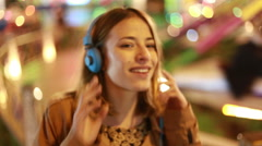 Blonde girl shaking her head to the rhythm of music with headphones Stock Footage