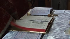 Priest close holy book during a religious service after reading a passage 01 Stock Footage