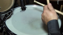 Bassist beat with sticks on a drum during a music concert Stock Footage