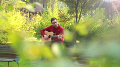 Man playing the guitar and singing Stock Footage