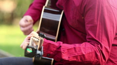 Man playing the guitar and singing - stock footage