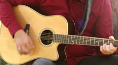 Man playing acoustic guitar - stock footage