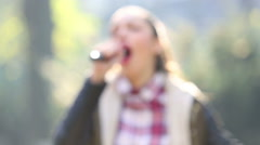 Beautiful woman singing with the microphone Stock Footage