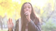 Portrait of beautiful woman singing with microphone Stock Footage