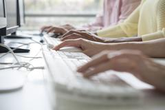 Professionals using desktop computers in training class, cropped Stock Photos