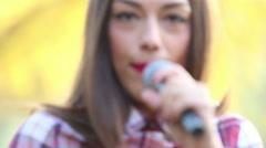 Beautiful woman singing Stock Footage