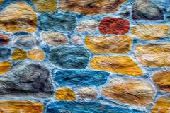 Painted Colorful Stone Wall - stock photo