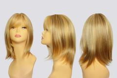 Wavy hair wig over the white plastic mannequin head - stock photo