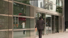 Chinese businessman on cellphone Stock Footage