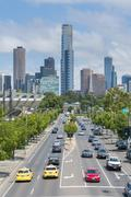 Modern buildings and busy road in downtown Melbourne Stock Photos