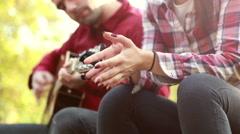 Man playing guitar while beautiful woman singing Stock Footage