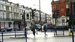 People crossing busy road, Crystal Palace, London. Stock Footage