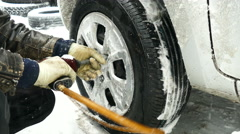 Torque wrench on winter car wheels close up Stock Footage