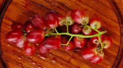 Red grape on wood Stock Footage