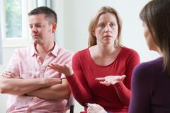 Couple Discussing Problems With Relationship Counsellor - stock photo