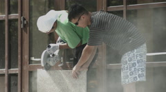 Two men slicing stone Stock Footage