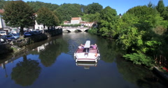 Touristic boat floats on the river in Brantome Stock Footage