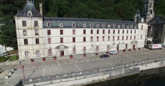 Aerial view of Benedictine Abbey of Brantome and river, France Stock Footage