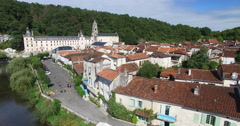 Benedictine Abbey of Brantome and river and surrounding Stock Footage