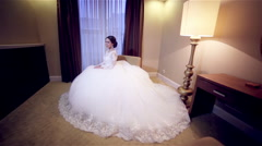 Bride in wedding dress in beaty room Stock Footage