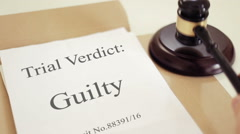 Trial verdict folder with gavel placed on desk of judge in court - stock footage
