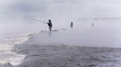 Fishermen stand in the water, in the middle of the river. Stock Footage