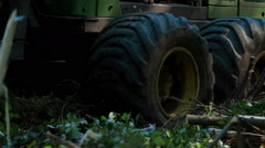Feller Buncher drives in forest Stock Footage
