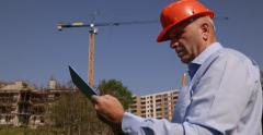 Building Site Engineer Hold Clipboard Check Plans Talk Cellphone Incoming Call Stock Footage