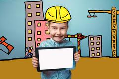 Adolescence girl enjoys the tablet in the hands of a builder in Stock Photos