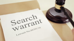 Search warrant document with gavel placed on desk of judge in court Stock Footage