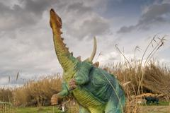 Gigantic dinosaur portrait at the park of dinosaurs in Greece. - stock photo