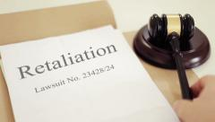 Retaliation lawsuit verdict folder with gavel placed on desk of judge in cour Stock Footage