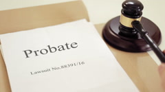 Probate lawsuit documets folder with gavel placed on desk of judge in court Stock Footage