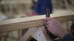 Carpenters measuring tape, are going to drill a hole - stock footage