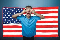 Adolescent the boy screaming shut her face American flag USA Stock Photos