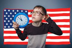 Adolescent the boy wearing glasses and holding an American flag Stock Photos
